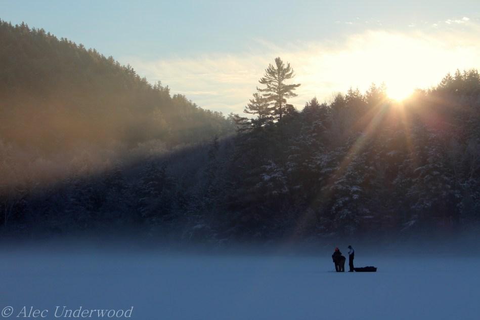 Ice fishing at sunrise